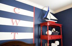 boy's rooms - blue walls white blue striped monogram walls red etagere bookcase  Red & blue boy's nautical bedroom with blue walls paint color,