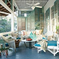 Love the use of old shutters on this pretty porch!