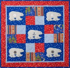 Learn how to make an adorable quilted wallhanging with polar bears this winter!