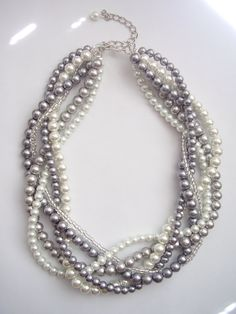 Custom order necklaces braided twisted chunky statement pearl necklace. $32.50, via Etsy.