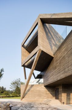 South Korean architect Moon Hoon has completed a concrete house on the island of Jeju, featuring cantilevered boxes stacked on top of each other and braced by diagonal reinforced-concrete beams.