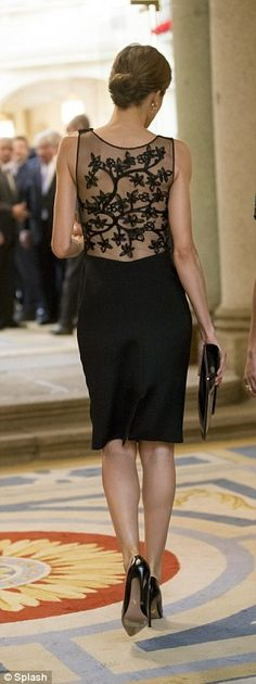 Letizia, who always impresses in the style stakes, wore a beautifully ornate sheer dress...