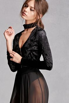 A knit velvet bodysuit featuring a V-cutout beneath the choker neckline, long sleeves, a partial zip front, and snap-button closure. This is an independent brand and not a Forever 21 branded item.