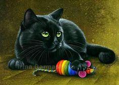 gatto nero con giochino
