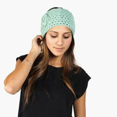 Open-stitched head wrap with a crocheted button and KK intl, button. Cozy and sophisticated -- be sure to check out 'the Juliet' | Krochet Kids intl.