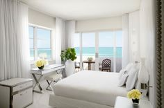 Luxurious Hotel Suites - Delano South Beach, Miami - The interior king is serving up top floor access, ocean-front views, a walk-in wet bar, an iPad in every room, and an imported marble soaking tub. The ocean is right at your fingertips. Cost per night will set you back about $ 3,700 | #Suites #Hotels #Miami #Travel |