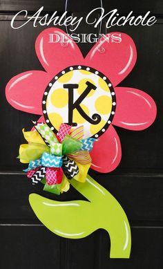 A cute way to welcome Spring! Greet your friends and family with these hand painted wooden door decorations made in the USA! This is a large