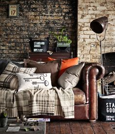 sofa and pillows. look at that beautiful brick wall!  tv room like this!!!! this is what i mean, the tv room off to the side - the dining room must be next to the kitchen and open plan with no tv, so that it is an effort to go into the tv room
