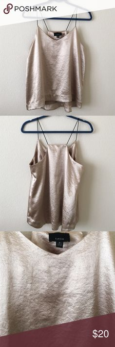 Gold Tank Top Shiny gold tank top! Never been worn!! Perfect for any night out! Tops Tank Tops