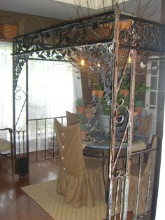 Arbor made from old porch post brought inside to dining room
