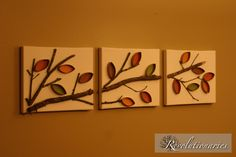 Real branches glued to canvas. Leaves made from toilet paper rolls with colored paper behind them.
