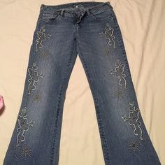 Bebe jeans, size 29, fits 2-4, stretchy Bebe jeans, 98% cotton, 2% spandex/ lycra, very stretchy and super comfortable! Slightly wide on the bottom, look amazing with a pair of heels! They are size 29 in jeans, they fit size 2-4 cause of spandex bebe Jeans Boot Cut