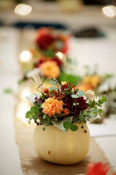 flowers in a small pumpkin as centerpiece