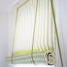 Swedish blind (click through to instructions). They look best with the swedish glass rings at the top rather than eyelets screws. Fabric: Sail Narrow Stripe fabric (J128F-02), Sail Check fabric (J184F-06 both Jane Churchill.