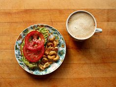 Roasted garlic toast topped with mashed avocado, sliced tomato, salt, pepper, and lime. Roasted cashews and coffee with vanilla soy milk.