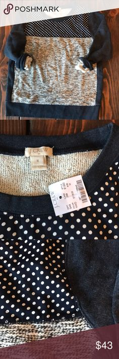 NWT J. Crew mixed media sweatshirt NWT J. Crew sweatshirt size medium. Back and sleeves are gray, neckline is navy and white polka dot, and the torso has a fun marled gray texture. Shoulder to hem: 24 inches. Chest: and 20 inches. Bundle to save! J. Crew Sweaters Crew & Scoop Necks