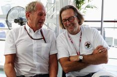 Eric Clapton Photos Photos - Red Bull Racing Motorsport Consultant Dr Helmut Marko (L) talks with musician Eric Clapton (R) before qualifying for the Italian Formula One Grand Prix at the Autodromo Nazionale di Monza on September 11, 2010 in Monza, Italy. - F1 Grand Prix of Italy - Qualifying