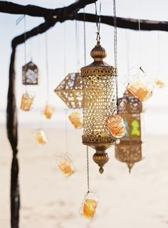 pretty gold moroccan lanterns with hanging votives