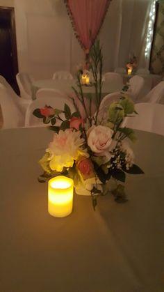 Floral centerpiece in Milk Glass vase