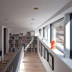 Modern white hallway with bookshelves | Hallway decorating | 25 Beautiful Homes | Housetohome.co.uk