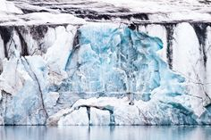 Waterfall in Ice | A gothic ice formation resembles a waterfall both above and in the descent, in St Jonsfjorden, Svalbard.