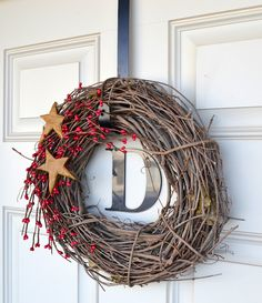 I've started my holiday decorating with a simple wreath for my front door.