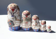 Matryoshka RUSSIAN Wooden Nesting Dolls Nurse Doctor Medical Staff and a Baby Hand Painted Signed Wooden Collectible Figurine Dolls.