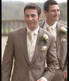 Brown suit with yellow wedding :)