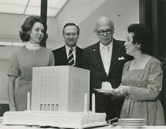 Elmer Holmes Bobst and his wife Mamdouha enjoy a cake replica of Bobst Library at a celebration in 1972. The new library was made possible i...