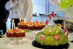 delicious cake with lollipops and cupcakes