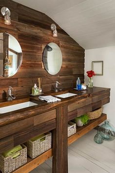 Pale walls and floors contrast with the wood vanity in this 1920s Montana farmhouse, while rectangular sinks and nickel faucets give it a modern update