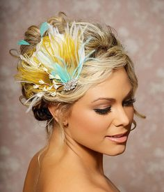 Jenny is a stunning fascinator with really sophisticated style and a wow pop of color. Its a beautiful combination of ivory feathers layered with