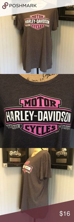 "Harley Davidson T-Shirt EUC. A pretty gray tee with a pink and white bar and shield on the front. Dealership on the back. Run small. Length 25"". Armpit to armpit 23"" Harley-Davidson Tops Tees - Short Sleeve"