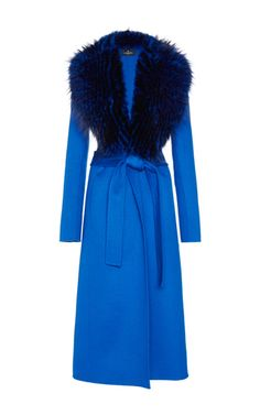 This **J. Mendel** coat features a fox fur trimmed shawl collar and a trench coat style.