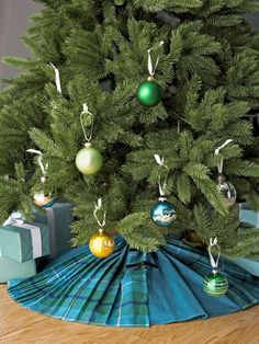 Create a DIY Christmas Tree Skirt Using Two Thrifted Plaid Kilts or Pleated Skirts. Homemade Holiday Decor How-To via Living Magazine Christmas Craft Projects, Christmas Crafts To Make, Country Christmas Decorations, Very Merry Christmas, Simple Christmas, Holiday Crafts, Christmas Holidays, Christmas Ideas, Holiday Decorating