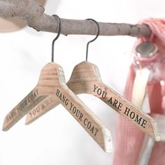 cute hangers for entrance & I like the wooden stick