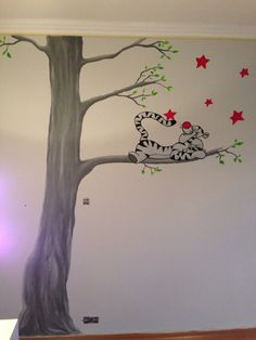 Wallpainting tigger muurschildering babyroom Disney tree and stars girlsroom