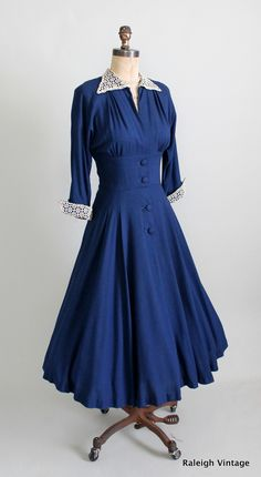 early 1950s New Look coat-style dress.    https://www.etsy.com/listing/110274819/vintage-1950s-dress-40s-50s-navy-new