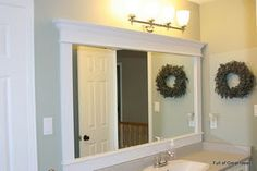 Build a frame around a plain mirror with crown mouding