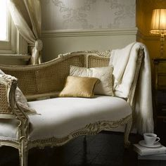 Antique French Upholstered Chaise with Caned Back