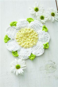 Daisy Dishcloth ~ Lily® Sugar'N Cream® Scrubby is worked into a fast nubbly stitch for the flower center, which is just the right size for pot scrubbing.