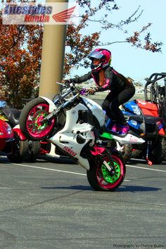 Drea Tunigami on a white and pink 2004 Ymaha R6.
