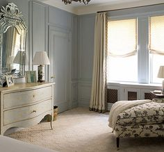 This pale blue/gray paint is so lovely in this more formal bedroom. The paneling helps make the room more inviting,