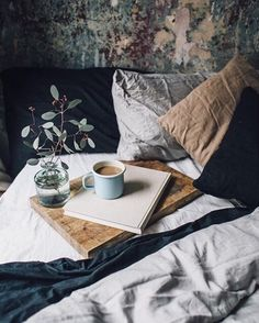 Hygge bedroom, cozy bedding with coffee