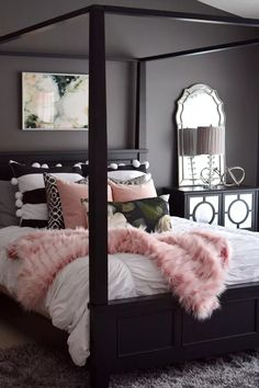 Gorgeous elegant bedroom in a dark moody gray with pretty pink accents