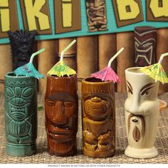 These 4 ceramic tiki mugs are brimming with retro 50s Hawaiian style. Dishwasher safe and sporing a hand painted finish, these restaurant-quality Hawaiian cups are just what you need to serve up tropical drinks at your next Polynesian party. Fun tiki barware with a Polynesian theme.