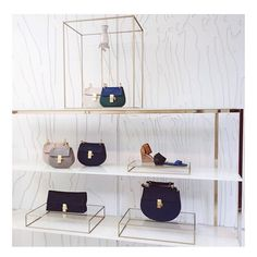 Dreamy Chloe store! Love the facade and the simplicity of the shelves for key product displays.