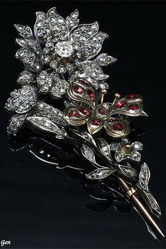 Diamond & Ruby Tremblant Brooch France circa 1820 Old European cut diamonds ( open setting ) , rose-cut diamond ( open setting ) , Ruby (Closed Settings ) , Silver & 18ct Gold , Size 3,8cm × 6,9cm weight 22,7g With antique leather case