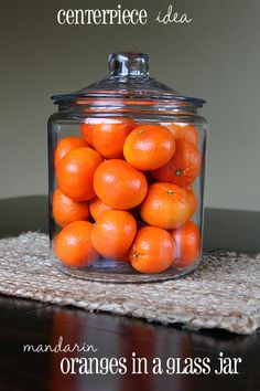 Centerpiece idea – fruit in a glass jar. I've got the oranges and I've got the jar... so why did I have to see this here??