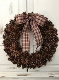 Best 12 New to the Fall/Winter 2018 collection! Make a cozy welcome statement with this beautiful Assorted Pinecone Wreath, completely handcrafted with natural Michigan pinecones! Each wreath is made unique, so your home will have a one-of-a-kind piece to Primitive Christmas Decorating, Rustic Christmas, Christmas Diy, Christmas Wreaths, Christmas Decorations, Christmas Ornaments, Xmas, Minimal Christmas, Christmas Patterns